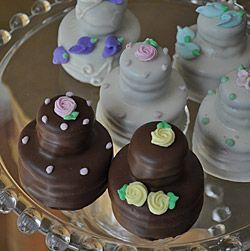 Chocolate dipped oreos - to look like mini wedding cakes!!