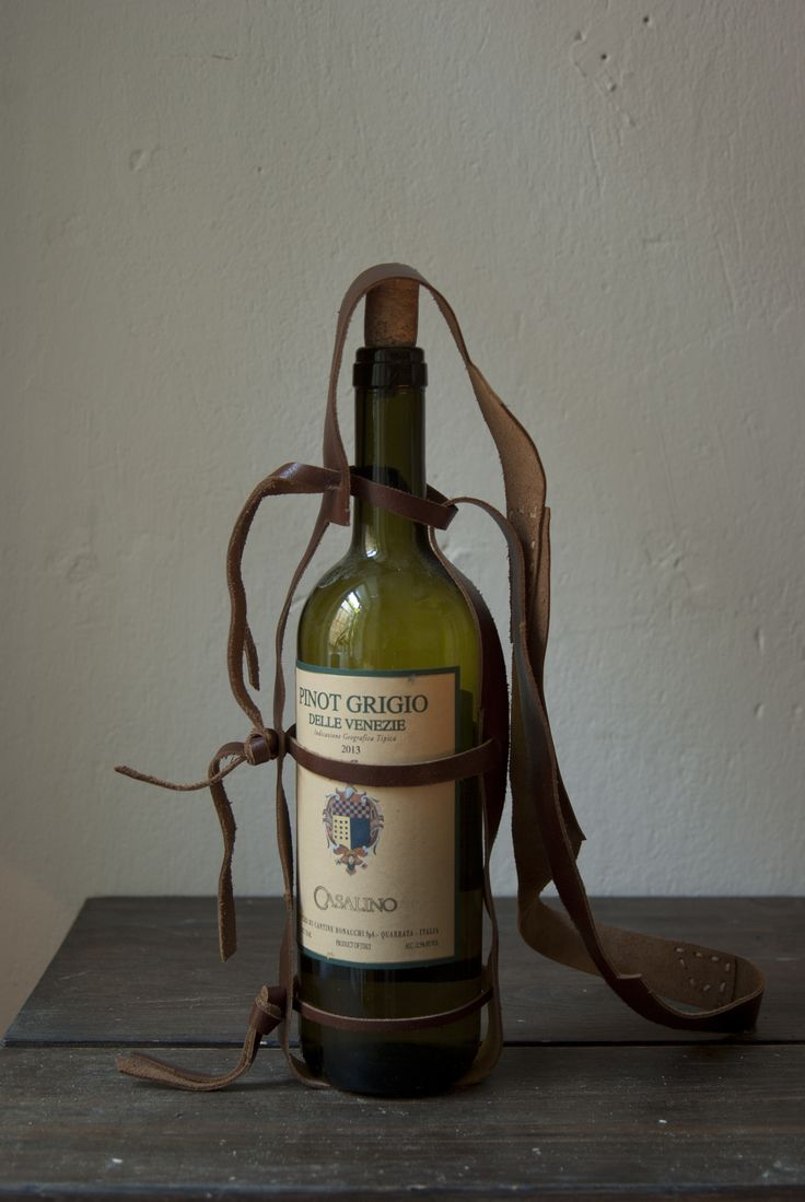 the leather carrier for one wine bottle