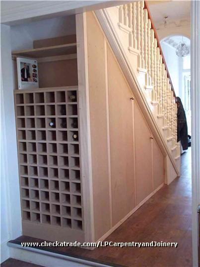 understairs cupboards and wine rack