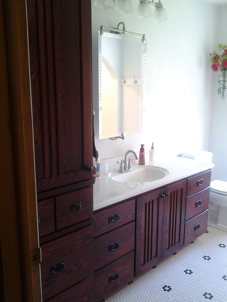 oak mission style vanity matching linen cabinet feature bathrooms