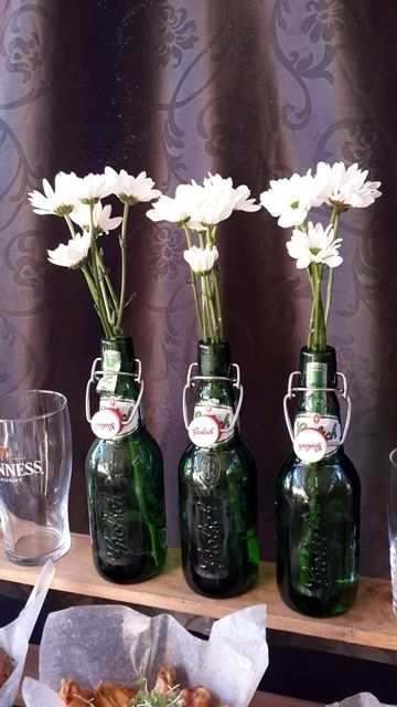 Flowers in Grolsch Bottles