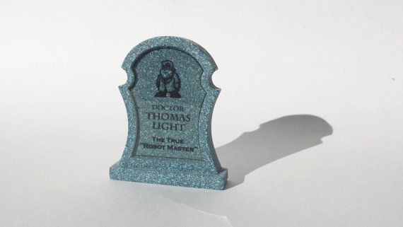 "This specific tombstones from the Mega Man X franchise is Dr. Thomas Light Epitaph Reads: ""The true robot master"" Available at www.ChinookCrafts.Etsy.com"