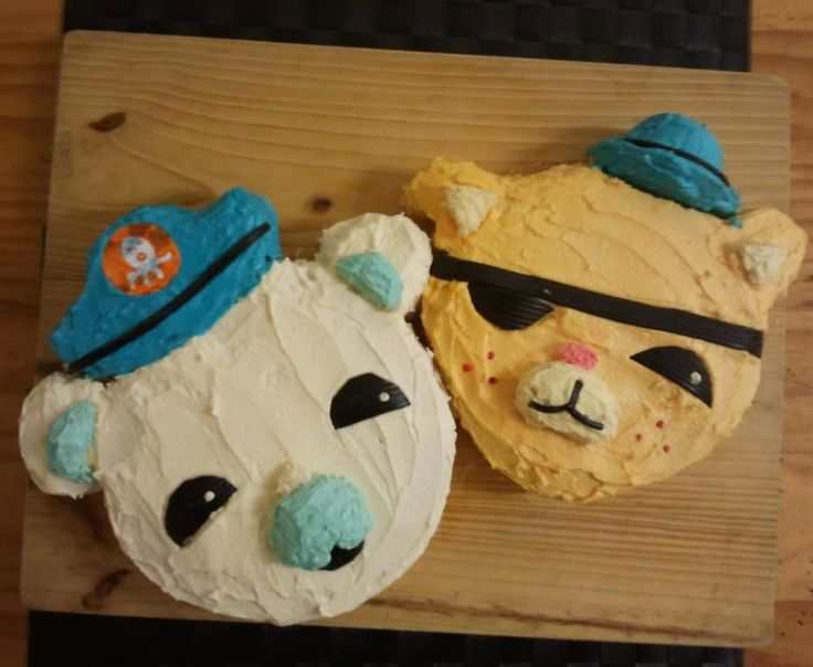 Octonauts cakes. 2 round cakes for heads; cut up another round cake for ears, noses, and hat. Use licorice for eyes and eye patch.