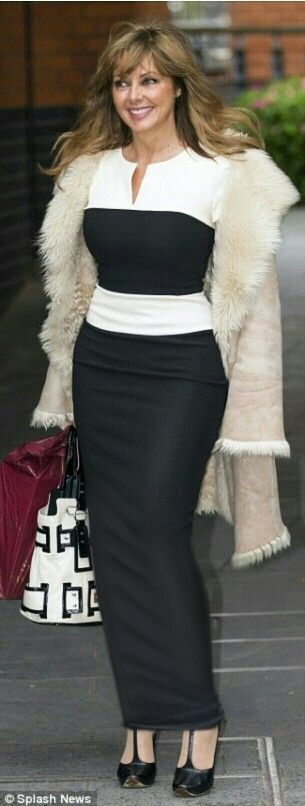 Carol Vorderman out wearing another long tight hobble skirt !