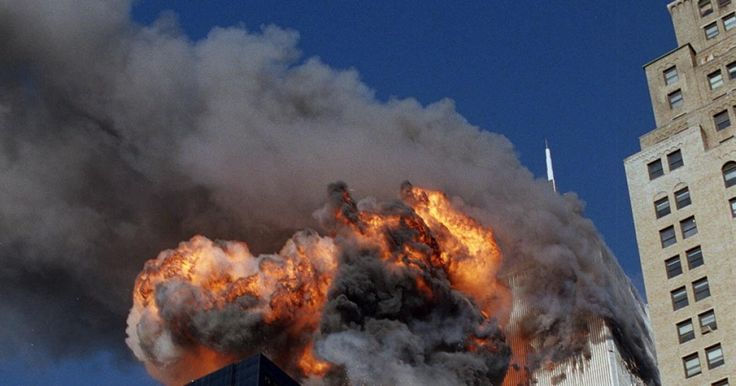 Smoke, flames and debris erupt from the South Tower as United Airlines Flight 175 hits. This flight was on route from Logan International Airport in Boston, Massachusetts to Los Angeles International Airport in California, the same path as the other plane that struck the North Tower.