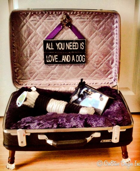Cre8tive Designs Inc repurposed this vintage suitcase as a dog bed for a charity auction. It raised $1300.00 for the  local boys and girls club