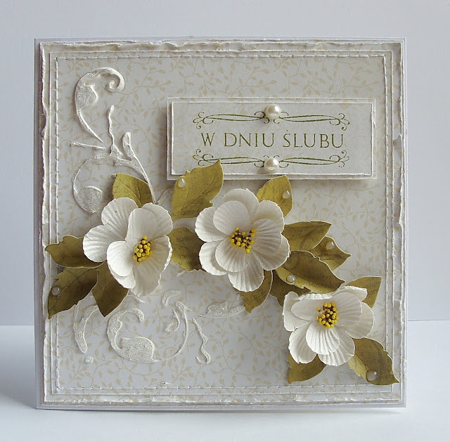 tutorial shows how to make the background flourish with gesso and a template...absolutely gorgeous card!!