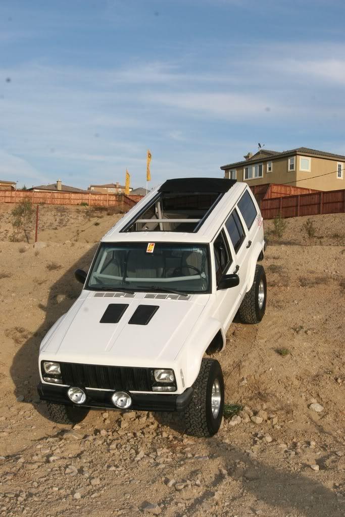 I like the custom roof on this Jeep Cherokee, way cool.