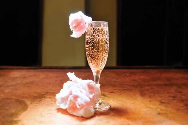 """11.) Garnish pink champagne with <a href=""""http://hercincinnati.com/articles/2013/01/25/cotton_candy_champagne_cocktail"""" target=""""_blank"""">cotton candy</a>."""