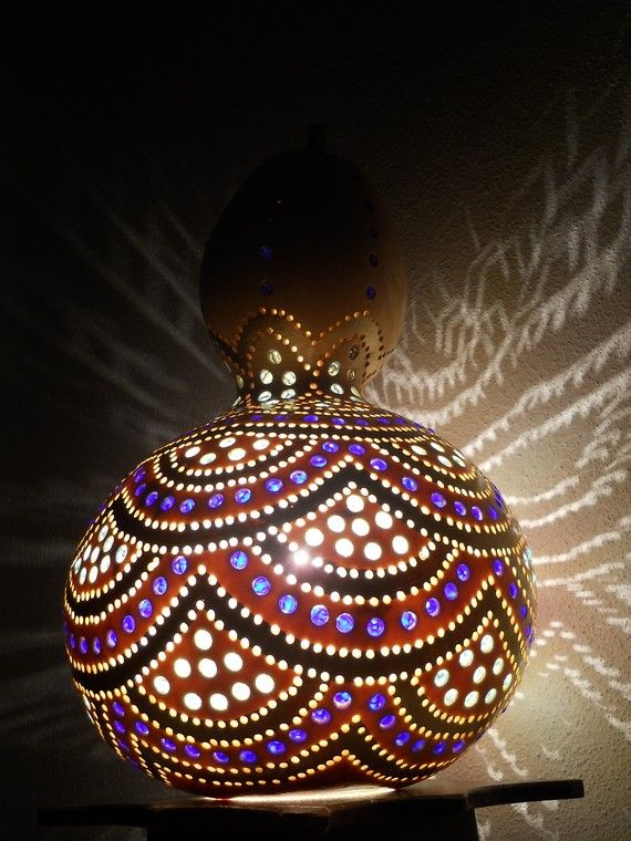 I love this gourd light!  I will try growing some of these next summer, and take the Dremel to them once they dry.  <3