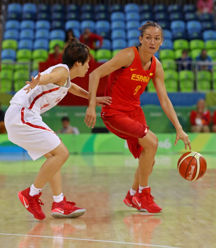 Sun Mengxin of China handles the ball against Laura Nicholls of during the women's basketball preliminary round in the Rio 2016 Summer Olympic Games at Youth Arena.