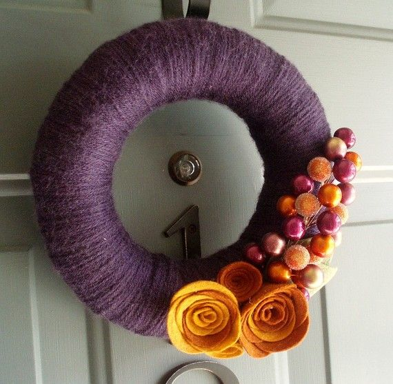 #wreath I like the yarn wrapping, maybe a lighter color for a spring wreath?  I wonder how the flowers are made.