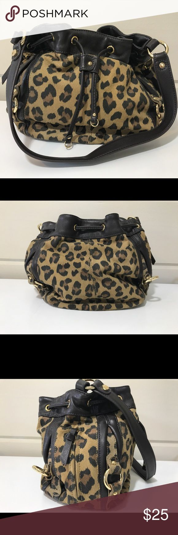 TIGNANELLO SUEDE LEOPARD PRINT BUCKLE BAG TIGNANELLO SUEDE LEOPARD PRINT BUCKLE BAG WITH GORGEOUS GOLD ACCENTS❤️ BAG IS IN EXCELLENT CONDITION PLEASE SEE 4TH PIC IT IS  MISSING 1 SMALL GOLD ACCENT DOES NOT EFFECT THE FUNCTION OF THE BAG AND IS NOT NOTICEABLE PRICE REFLECTS THIS OTHER THAN THAT THE INSIDE AND OUTSIDE IS IN GREAT CONDITION ONLY USED 2 TIMES ! Tinganello Bags Satchels