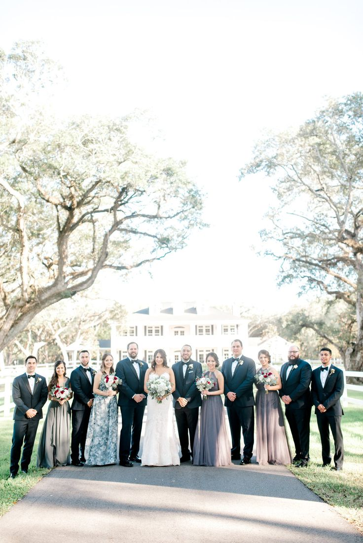 such an elegant blue + grey bridal party! love how elegant + classy this wedding was from the wedding venue to the attire. taken at THE SPRINGS in Angleton, Magnolia Manor.  follow this pin to our website for more information, or to book your free tour! photographer:  Kaley Elaine Photography #bridalparty #bridalpartyideas #elegantwedding #elegantbridalparty #classywedding #classybridalparty #uniqueweddingideas #weddingphotos #bridalpartyphotos #houstonwedding