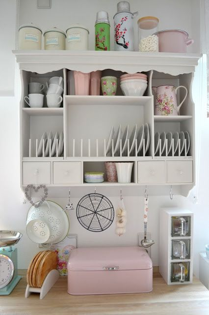 Looks like top of a hutch hung on the wall. Cute idea.