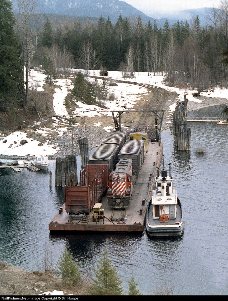 The northbound Nakusp wayfreight aboard barge and tug Iris G docks at Rosebery on Slocan Lake where it will unload and continue on the isolated Kaslo branch to Nakusp.