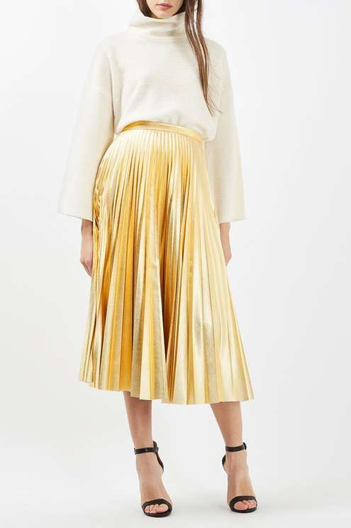 Metallic details add a pretty touch to this midi skirt. Sitting high on the waist, the full skirt comes in a pleated texture. Pair with a simple vest and black heels for instant glamour. #Topshop