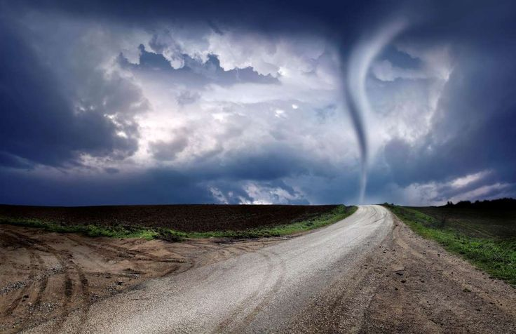 twister and empty country road. -------------------------- Please see some similar pictures from my ... - Imagedepotpro/Getty Images