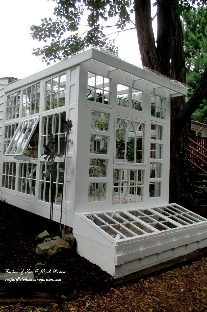 Building a Repurposed Windows Greenhouse ~ you can make a greenhouse inexpensively using old windows! #conservatorygreenhouse