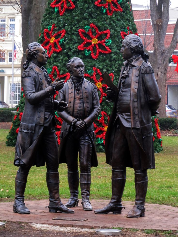 Statue of the Marquis de Lafayette informing General George Washington and Colonel Alexander Hamilton that the French will support the Americans. AKA, LAFAYETTE TAKIN THIS HORSE BY THE REINS MAKIN REDCOATS REDDER WITH BLOODSTAINS