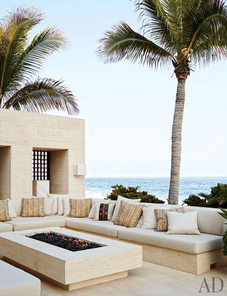 Cindy Crawford and Rande Gerber and Neighbor George Clooney's Side-By-Side Mexican Villas. OUTDOOR LIVING ROOM Made of niwala limestone from Spain, the outdoor living room's seating is topped by cushions clad in a Ralph Lauren Home fabric.