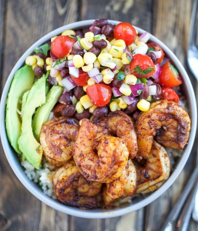 Spicy Shrimp Burrito Bowls recipe with cilantro lime rice and a corn black bean…