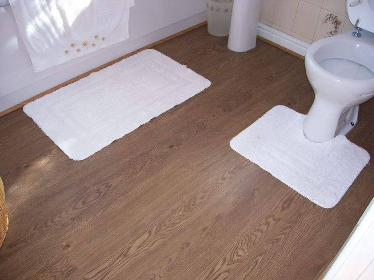 Best 25 waterproof flooring ideas on pinterest - Laminate tiles for bathroom walls ...