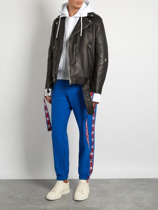 When the radical Paris-based Vetements began riffing on the Champion brand, the sportswear company took it as a compliment and they're now collaborating to produce pieces like these blue cotton-blend jersey track pants.