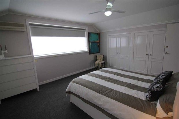 Selling Houses Australia use Luxaflex® Dual Roller Blinds to transform the 1980s style house into a modern family home.