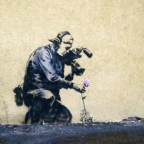 Banksy is an England-based graffiti artist, political activist, film director, and painter. His satirical form of street art and subversive epigrams combine irreverent dark humor with graffiti done in a distinctive stenciling technique.