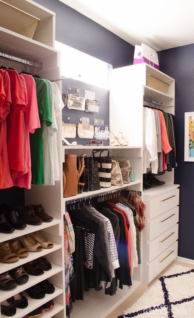 Walk-in master closet organization - shoe storage, organized purses, drawers, and hanging space all on one side of a walk-in closet! Dreamy!