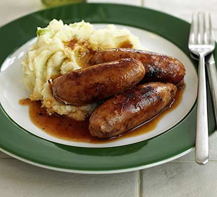 Bangers & Mash, continued.  4. Strain the potatoes and mash = with a ricer if you have one. Add the cream, butter, sour cream and mustard. Blend well. Season to taste with salt and pepper. Serve bangers together with a mound of the mash, and ladle some of the gravy over the entire thing. Serve with grainy mustard.