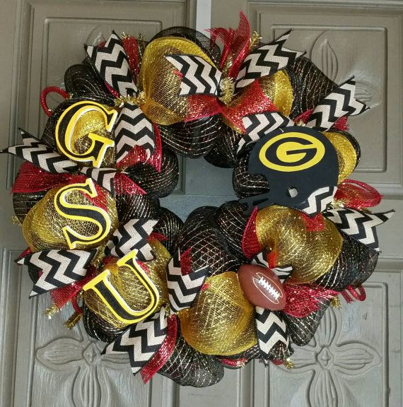This is a gorgeous 24 Grambling State Tigers deco mesh wreath. It has black, gold and red metallic mesh, with black and burlap chevron ribbon throughout. The GSU letters and helmet are both hand painted and sealed with a spray gloss paint sealer. I can customize any wreath, just