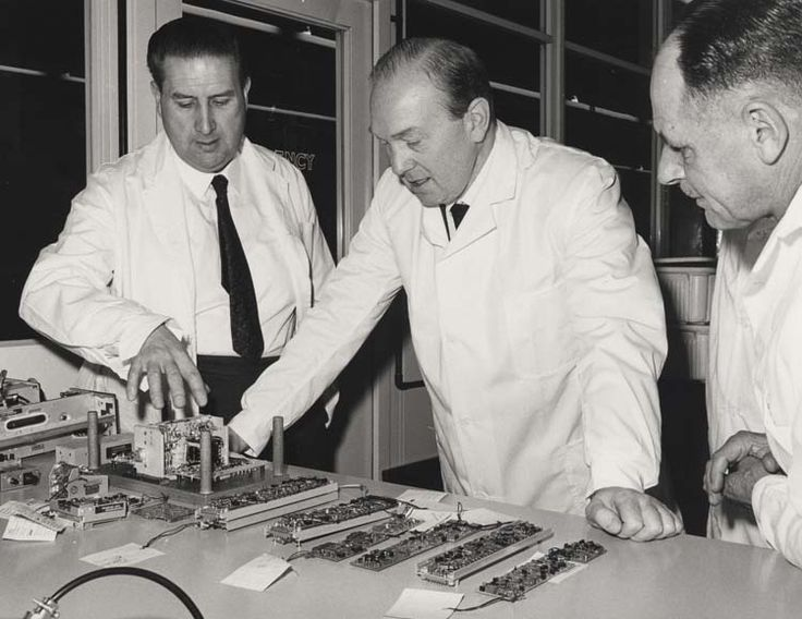 Sir Kenneth George Corfield  [centre] visiting the I.L.S. [instrument landing system] laboratory, radio division, 1970, V.3519-6