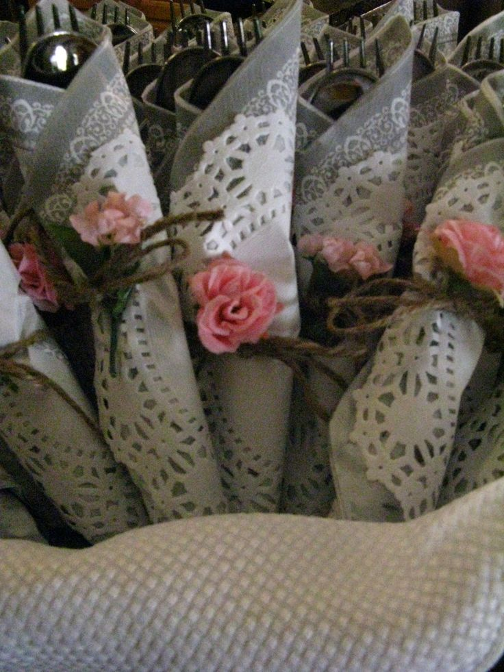 """This pic is from the bridal tea party we just had at our house!  Bought the """"shiny"""" plastic silverware.... Serve your guests plastic silverware - just wrap the napkin in a Doily and tie with twine.  Add a silk flower for ambiance/romance"""