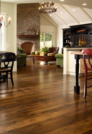 love this flooring for a well-lit house- wide plank flooring - walnut