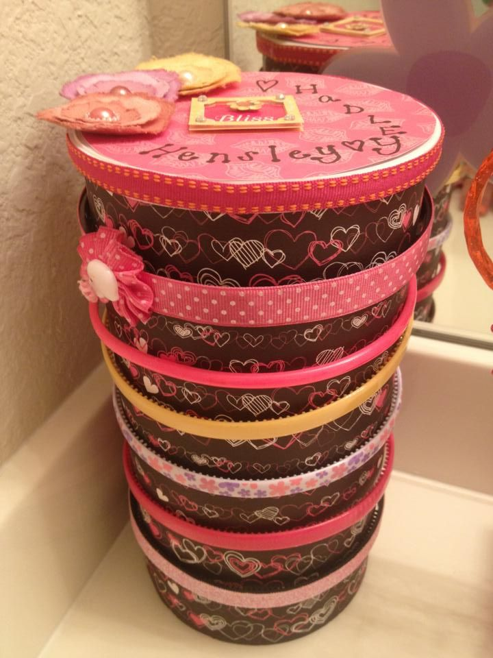 Headband Holder -- Thanks to my friend Laura for getting crafty with an Oatmeal container, craft paper and glue! Waala!