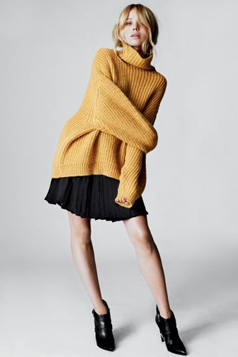 Elin Kling in Marciano oversize chunky knit over pleated full skirt