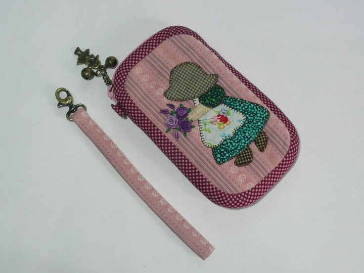 Lilac + purple bias. Standard case come with a wristlet but you can order a neckstrap.