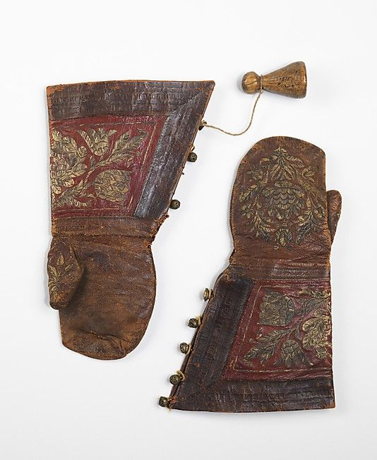 Mittens  Date:     late 17th century Culture:     Russian Medium:     leather, metal, bone Dimensions:     14 3/4 in. (37.5 cm) Accession Number:     2009.300.2681a–c