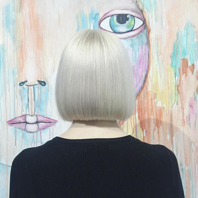 Back view of short blonde blunt bob haircut for women