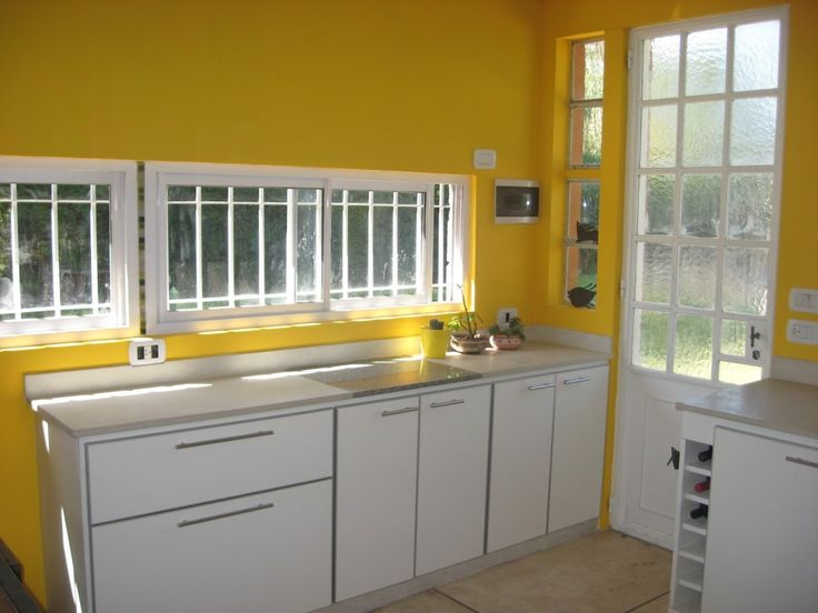 Living Room : Yellow Wall Painted Color Also White Cabinets With White Kitchen Counter And Kitchen Furniture Besides Kitchen Decoration And Furniture Cheerful Kitchen Kitchen In Color Themes Kitchen Inspirations Awesome And Luxury Design Find Inspiration Kitchen Design Part 3 Stainless Steel Sink. Kitchen Design Inspiration. Cupboards.