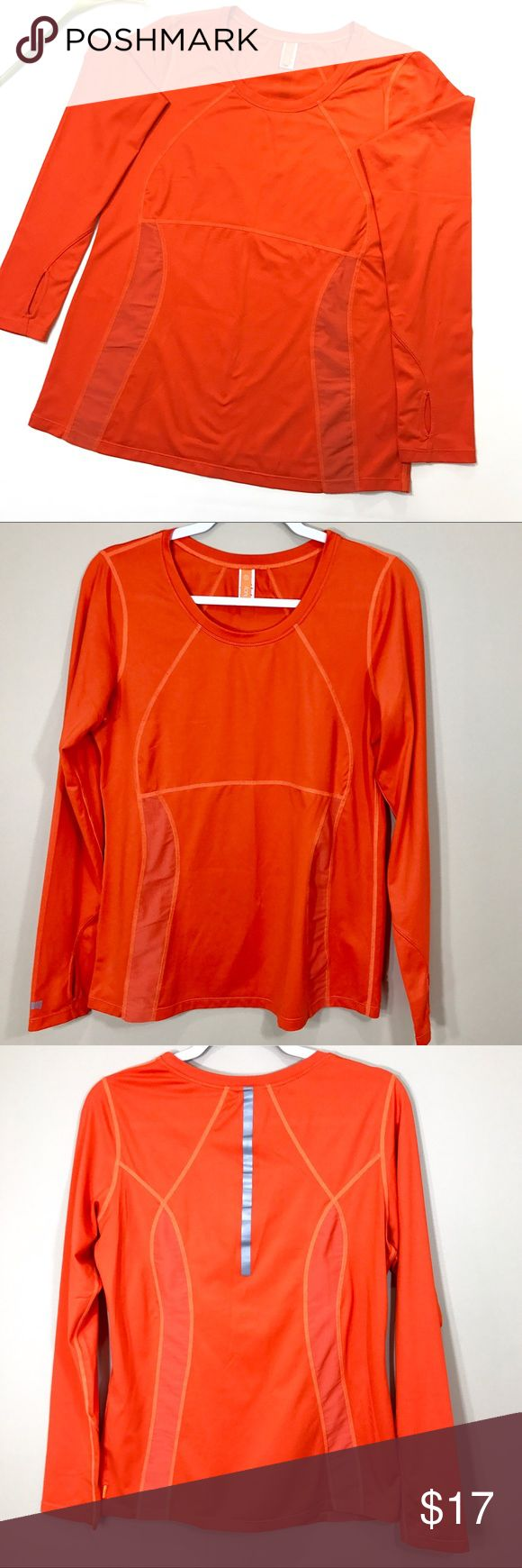 Lucy Workout long sleeve top size L This vibrant orange long sleeve top is perfect for when you head out for a run or workout. The thumbhole is perfect to keep your hands warm on a chilly day and the back reflective is necessary for a low visibility day. The top also comes with mesh venting on the front and back that will allow room to breath. Lucy Tops