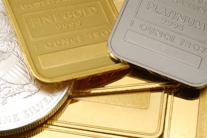 Various Gold and Silver Bullion Bars and Coins.