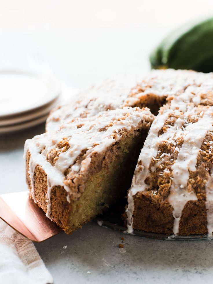 When you have more zucchini than you know what to do with, make cake! Coconut Zucchini Coffee Cake is speckled with zucchini, coconut & a delicious streusel.