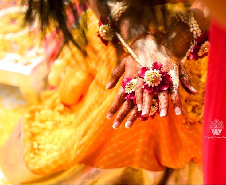 We can't stop drooling over this ring connected to the bracelet! #indianbride  #mehndijewellery #floraljewellery #bracelet #shaadisaga