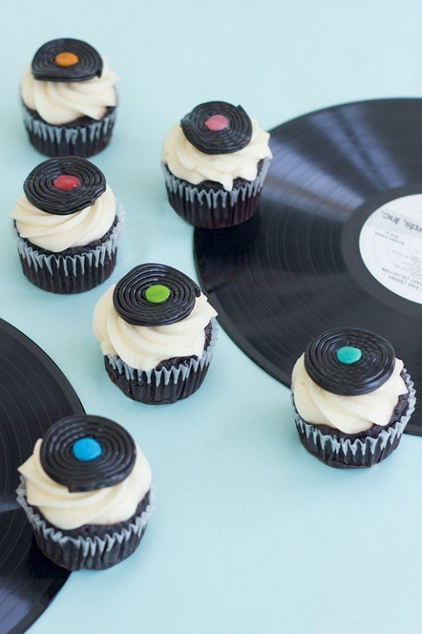 Transform black licorice wheels into records. | 27 Ridiculously Creative Ways To Decorate Cupcakes
