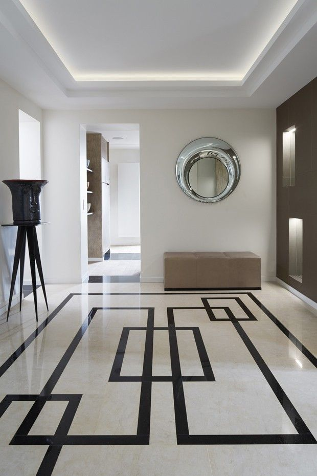 FORMAS e LUZ - formas geométricas no piso chamam atenção no ambiente. A sanca retangular com iluminação compete a atenção com o piso, na foto.