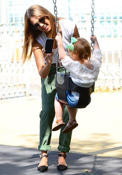 Jessica Alba filmed daughter Haven on a swing set in a NYC park on Sept.6,2013