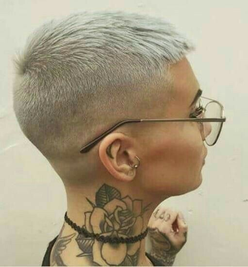 Beautiful blonde pixie fade. Tattoos and glasses. Gorgeous.